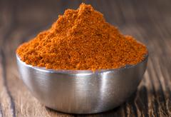 Bowl with paprika powder Stock Photos