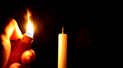 Lighting Candle using lighter Stock Footage