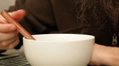 Man with beard eating soup; close up;  Stock Footage