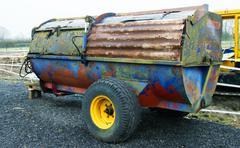 Multi colored muck spreader - stock photo