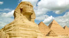 Timelapse of the famous Sphinx with great pyramids in Giza valley, Cairo, Egypt - stock footage