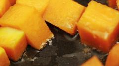 Pumpkin pan frying macro Stock Footage