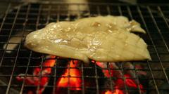 Squid roasting Stock Footage