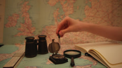 Making measurements on old map, writing in a notebook, geography - stock footage