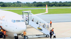 People arrive from a flight at Cuiaba Airport, Brazil Stock Footage