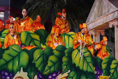 Costumed People on a Mardi Gras Float Throw Beads NTSC 4129 Stock Footage