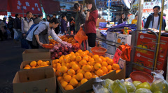 Hong Kong Chinatown Sham Shui Po grocery vegetable market shopping China Asia - stock footage