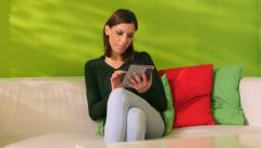 Woman relaxing on sofa with ebook 1of3 - stock footage
