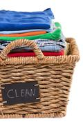 washed fresh clean clothes in a laundry basket - stock photo