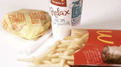 Fast food meal rotating on white Stock Footage