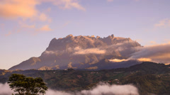 Moving Cloud Against Kinabalu Low's Peak - Zoom In Stock Footage