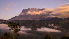 Moving Cloud Against Mount Kinabalu Peak - Pan Up Stock Footage
