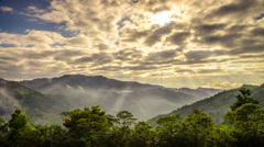Moving Cloud With Ray Of Light And Ground Mist Over Valley Stock Footage