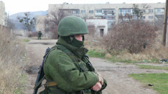 Russian soldier guarding a naval base on March  4, 2014 in Perevalne Stock Footage