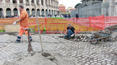 Colosseum stone worker long shot Stock Footage