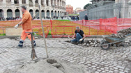Stock Video Footage of Colosseum stone worker long shot