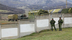 Russian soldiers guarding a naval base on March  4, 2014 in Perevalne, Crimea Stock Footage