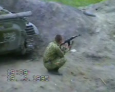 A soldier is firing from the machine. Grozny, Chechnya in 1995. Stock Footage