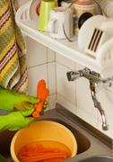 Stock Photo of woman hands slicing carrots in kitchen. healthy nutrition