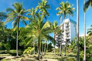 Stock Photo of luxury hotel on hawaii with palms trees in background