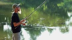 Sports fisherman fishing on lake Stock Footage
