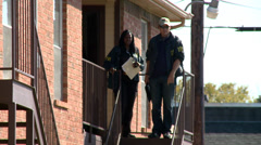 FBI Agents at a Crime Scene - stock footage