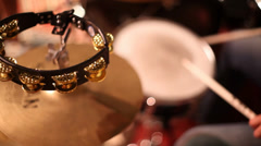 Tambourine being played with drums. - stock footage