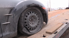 Car damaging large potholes on city streets Stock Footage