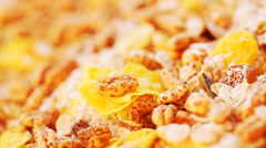 Corn flakes and muesli close up spinning Stock Footage