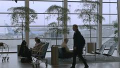 0291 Copenhagen airport. Passengers waiting in the lounge Stock Footage