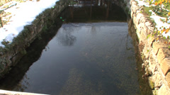 Clear stream flowing under the watermill Stock Footage
