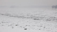 Frozen river Danube at winter - ice floating over river surface - stock footage