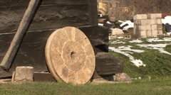 Old millstone leaning on the mill - stock footage
