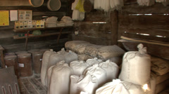Sacks of grains ready for grinding in old watermill Stock Footage