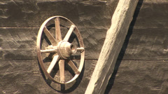 Old cart wheel hung on the watermill wall Stock Footage