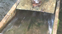 Stream flowing under the watermill Stock Footage
