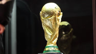 Stock Video Footage of People posing next to the world cup 2014 trophy