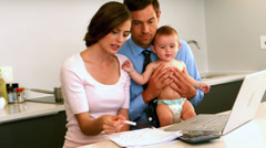 New parents trying to figure out their expenses Stock Footage