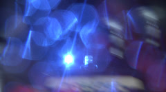 Blue and white police car with flashing light travels along road Catania Stock Footage