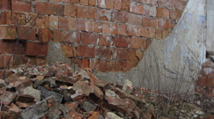 Old brick wall wreckage brick beside her Stock Footage