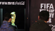 Stock Video Footage of People posing next to the world cup trophy