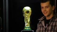 Stock Video Footage of Time-lapse of people posing next to the world cup trophy