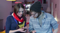 Woman shows photos in phone smiling, young couple flirting HD Footage