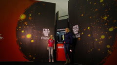 People posing next to the world cup trophy - a time lapse shot - stock footage