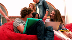 Happy students relaxing in common room Stock Footage