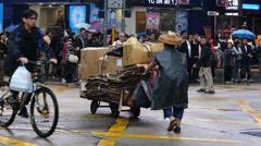 Hong Kong cleaning woman pushing paper waste Nathan Road China Asia Stock Footage