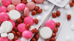 Various pills and medications on rotating stand Stock Footage