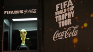 Stock Video Footage of World Cup Trophy 2014 exposed to the people, the shot goes from right to left