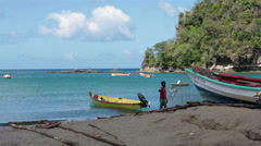 Fisherman at boats Soufriere St Lucia beach 2 HD 1578 Stock Footage