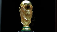 Stock Video Footage of World Cup Trophy 2014 exposed to the people - a guy shows thumb up
